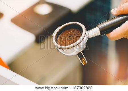 Barista Holding Portafilter With Ground Coffee In Cafe For Prepare To Make Espresso Coffee.