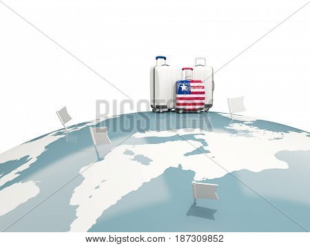 Luggage With Flag Of Liberia. Three Bags On Top Of Globe