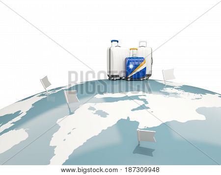 Luggage With Flag Of Marshall Islands. Three Bags On Top Of Globe