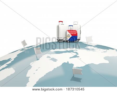 Luggage With Flag Of Sint Maarten. Three Bags On Top Of Globe