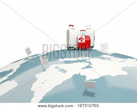 Luggage With Flag Of Tonga. Three Bags On Top Of Globe