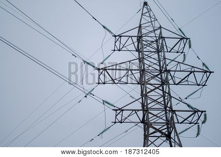 High voltage electric tower elements with sky background