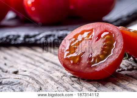 Fresh cherry tomatoes. Ripe tomatoes on oak wooden background.