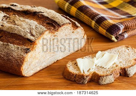 Rustic bread with bran close-up. Healthy whole wheat bread with crispy crust