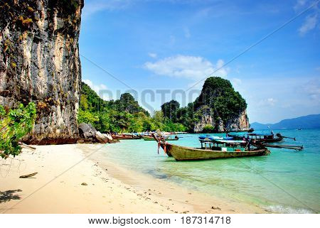 Longtail boats visiting the golden beaches in Thailand