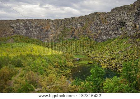 Asbyrgi Canyon In Jokulsargljufur National Park And Green Lake With Refflection, Iceland
