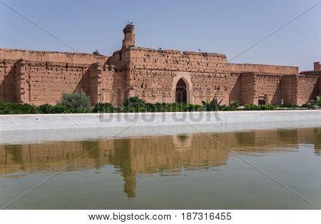 Wall's Reflection In Pool Of El Badi Palace Or Palais El Badii In Marrakech, Morocco