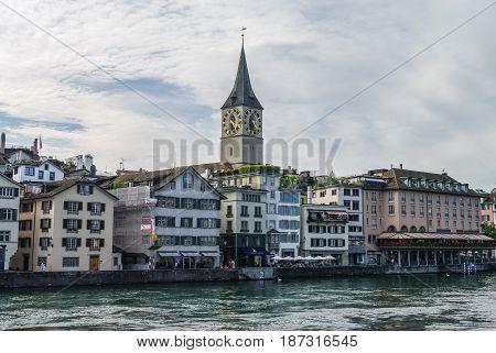 Zurich, Switzerland- August 22, 2010: View of embankment Limmat river in historic Zurich city center Canton of Zurich.