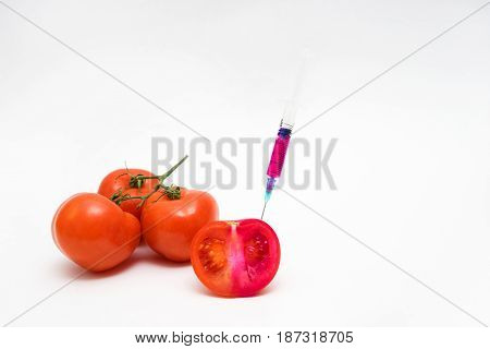 Gmo Concept On White Background With  Syringes And Tomatoes.