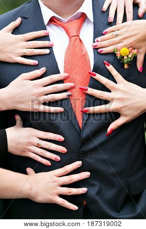 love and sex concept - female hands touching man in suits over grey background.
