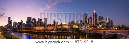 Melbourne cityscape during the set in Victoria state, Australia. Panorama view.
