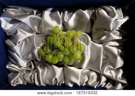 A small improvisation with green grapes berries