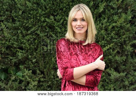 Beautiful Young Blonde Woman In Green Leaves Background