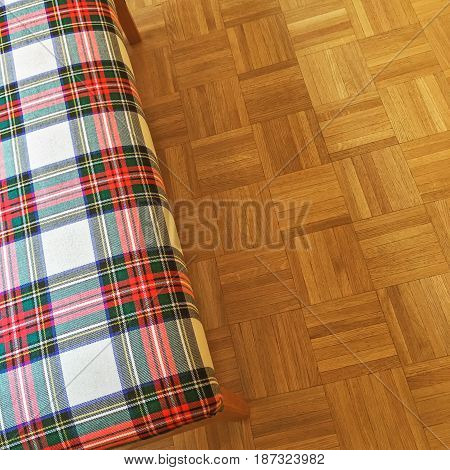 Colorful checked textile banquette on parquet floor.