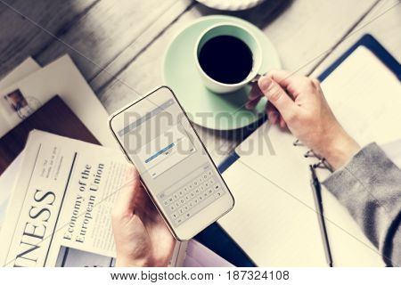 Hands Holding Downloading Mobile Phone with Coffee Cup Beverage