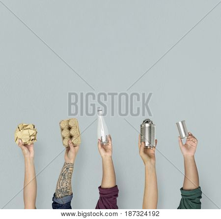 Ecology human hand holding stuff for recycle