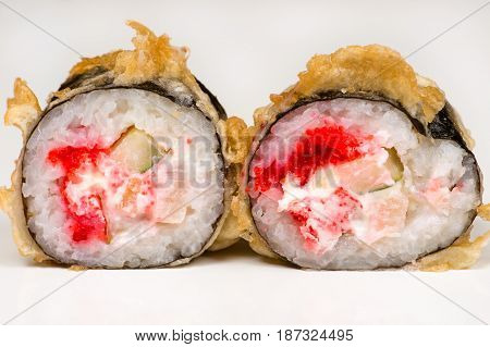 two beautiful sushi roll with crab closeup