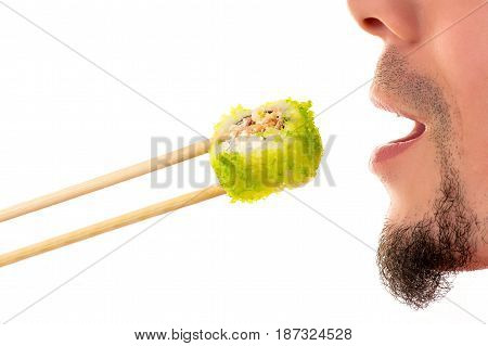 man eating roll closeup isolated on white background