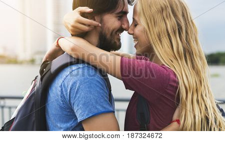 Couple staring at each other city background