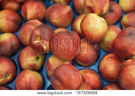 Nectarine is known as the hairless state of peach. Sold in the market. It is juicy and sweet compared to peach nectar.