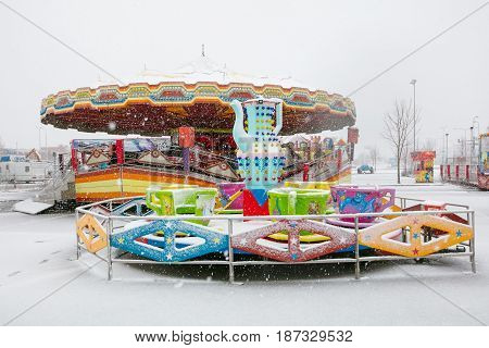 Tallinn, Estonia - Aprill 29, 2017: Empty Snowy Carousel During A Sleet. Snow Storm In The Spring Ti