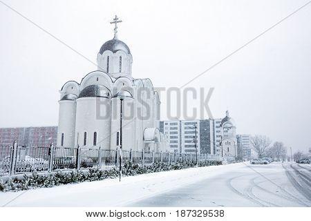 Tallinn, Estonia - Aprill 29, 2017: Orthodox Church. Snow Storm In The Spring Time.