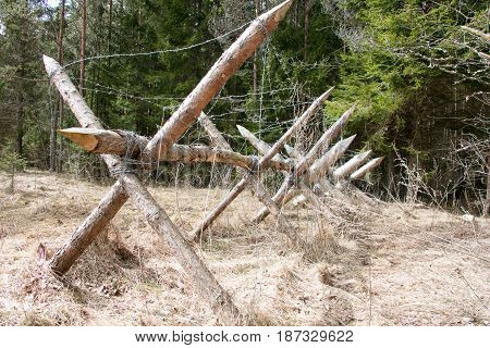Wooden Barricade With A Barbed Wire