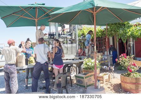 ROBERTSON SOUTH AFRICA ON ROUTE 62 - 21 December 2016: Mobile bottling plant at Le Roux & Fourie Boutique winery stall on Route 62 with people bottling and packing boxes - Illustrative Editorial Image