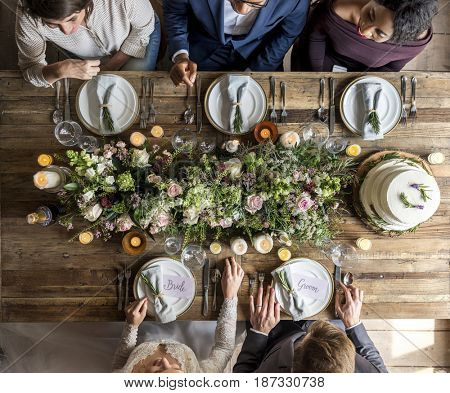 Bride and groom celebrate wedding ceremony with guests