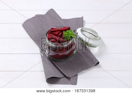 jar of beetroot strips on grey place mat