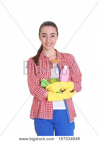 Beautiful young woman holding cleaning supplies for window on white background