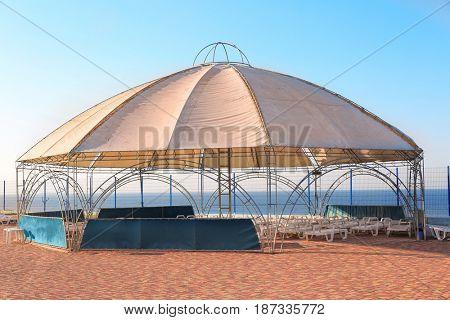 Empty sunbeds under a canopy