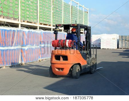 Stacking truck and goods for wholesale distribution outdoors