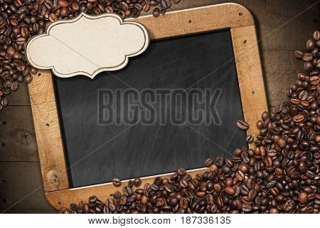 Empty blackboard with copy space blank label and wooden frame on a wooden background with roasted coffee beans