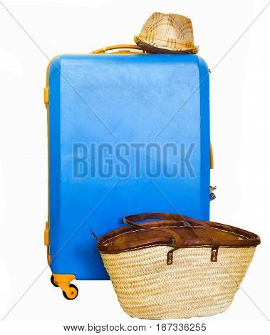 Large bright blue with orange polycarbonate plastic suitcase or travel bag with straw hat and womans vacation bag isolated on white background