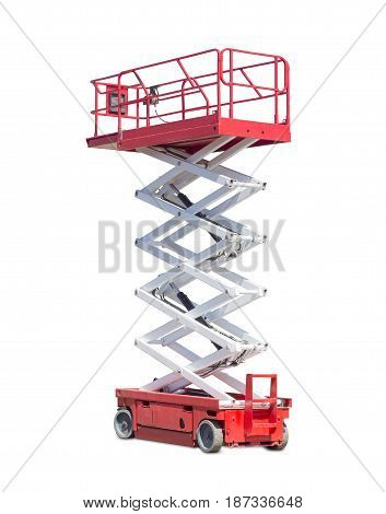 Mobile aerial work platform - red and white scissor hydraulic wheeled self propelled lift on a light background.