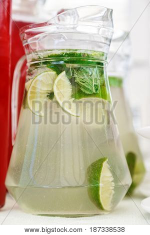 Refreshing lemonade from lime and mint home cooking in a jug