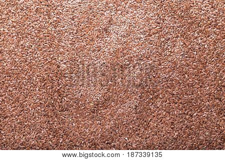 a lot of flax seeds are scattered as a background, close up