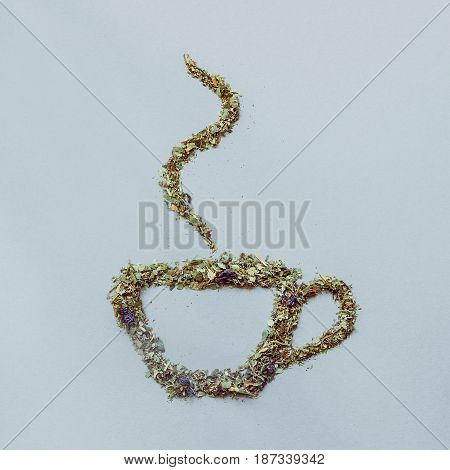 Dry Tea Placed In The Shape Of A Cup On The Gray Background