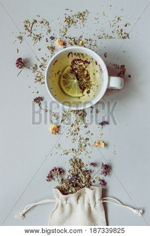 Tea Time. Dry Herbal Tea And Cup Of Hot Tea On The Gray Background