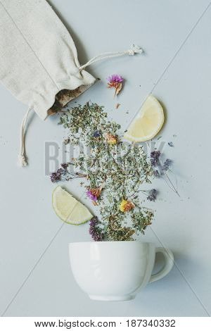 Tea Time. Dry Herbal Tea And Cup On The Gray Background, Top View