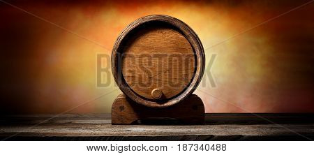Wooden cask for liquid on old timber table