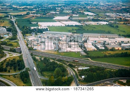 Bergamo, Italy - July 01, 2015: Aerial View Of Highway Interchange On The Sp591bis Highway Near Orio Al Serio International Airport. View Of Retail Space, Logistics Center.