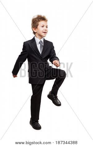 Handsome smiling young businessman child boy walking for next achievement or promotion step white isolated