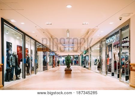 Tallinn, Estonia - December 2, 2016: Shops with clothes at the modern shopping mall Kristiine Shopping Centre