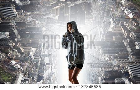 Young boxer woman outdoor . Mixed media . Mixed media