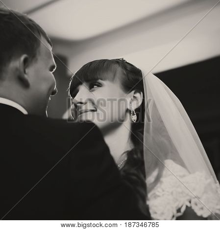 Adorable Bride Looks At A Groom With Love