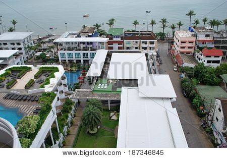 Aerial view of a hotel pool territory neighborhood buildings and Jomtien Beach at Pattaya Chonburi Thailand