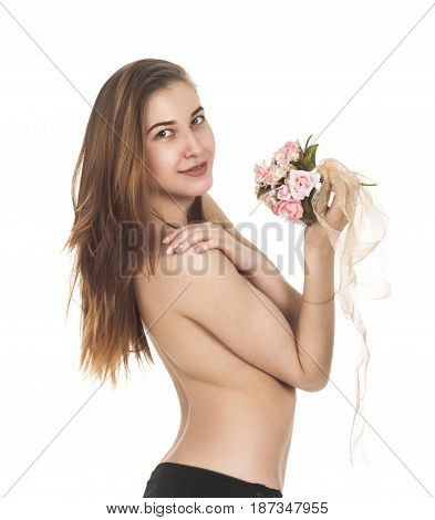 A young,naked girl smiling and posing with a bouquet of flowers. Studio shot on white background, isolated image.