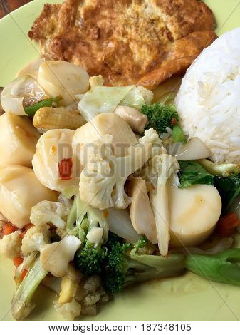 Fried Tofu With Vegetables And Thai Omelette (scrambled Eggs) In Green Dish On Wooden Table. Thai St